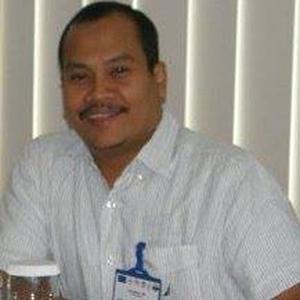 Dr. Edy Ikhsan, SH. MA